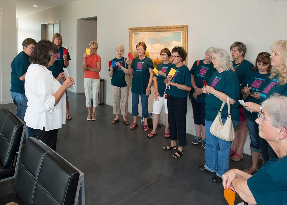 Beth Novotny (left front) leads the Apple Patch Quilting group on a docent led tour